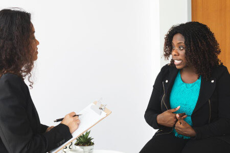 Photo of two woman doing an interview